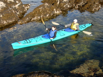 Paddling is easy in a double kayak on our Guided Sea Kayaking Tours